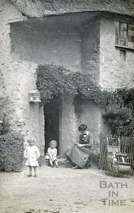The photographer's wife Violet and twin boys outside most probably a holiday cottage near Minehead c.1914
