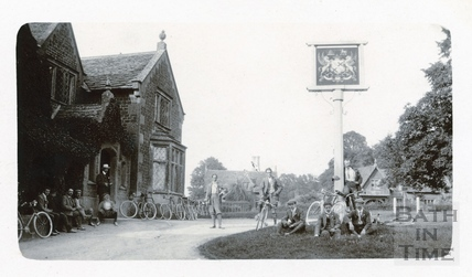 George Love Dafnis stands in the centre of this group shot of cyclists, outside the Lansdowne Arms, Derry Hill, WIlts c.1900