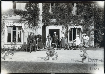 An Edwardian group with bicycles outside a grand by unidentified house c.1892