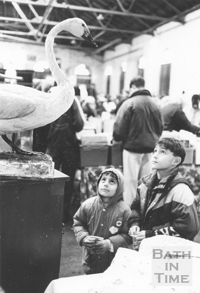 Two boys look up at a stuffed swan in the Tramshed Flea Market, Walcot Street, Bath 5 Dec 1992