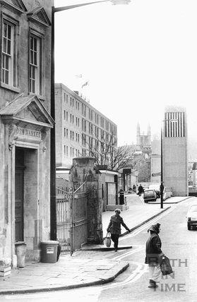 The entrance to the Corn Market, with the Beaufort Hotel and ventilation shaft in the background, Walcot Street, 24 Jan 1983