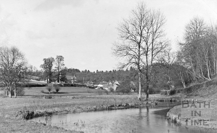 View of Castle Combe from the river, c.1910