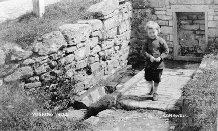 Wishing Well, Conkwell, with small child in the foreground c.1910