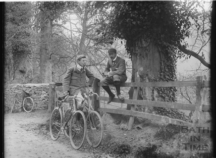 The photographer and a friend take a break on a cycling trip, possibly at Castle Combe April 29 1900