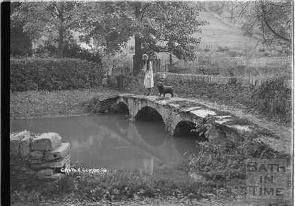 The photographer's wife Violet and dog on the bridge at Castle Combe No.9 c.1930s