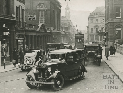 Stall Street looking south with lots of traffic, including trams c.1930s