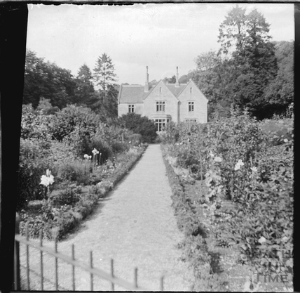 View of unidentified house and garden c.1900