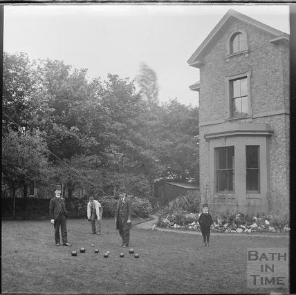 Lawn bowls in an unidentified back garden c.1900