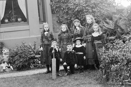 Detail of a family portrait outside an unidentified building c.1900