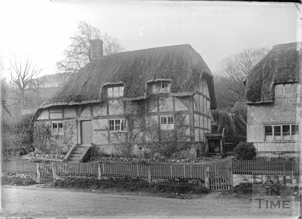 Unidentified timber-framed, thatched cottage, Keevil, Wiltshire c.1930