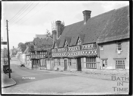 Timber-framed buildings in the High Street, Potterne, Wiltshire c.April 1935