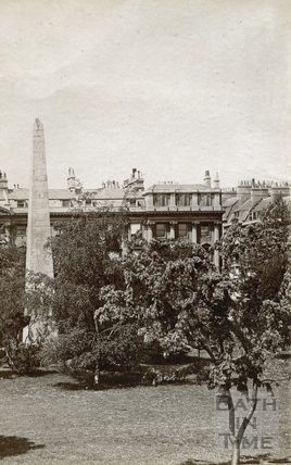 A fragment of a view of the north side of Queen Square, and obelisk c.1900