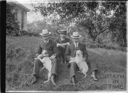Three Gentlemen and two dogs in the grounds of an unidentified house c.1910