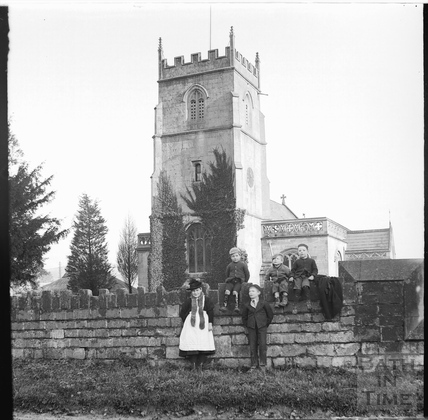 Group of people outside St Nicholas church, Bathampton, c.1892
