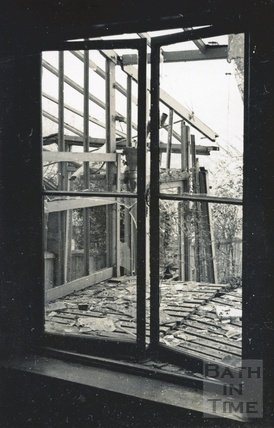 Looking through the window of a bomb damaged 32 Sydney Buildings 1942