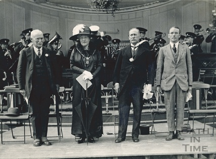 Mayoress Madame Sarah Grand posing on the Bandstand at Royal Victoria Park with the Mayor Cedric Chivers and others, 1920s
