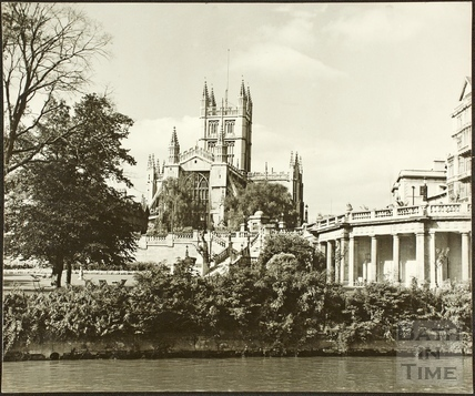 View of Bath Abbey from the River Avon showing Parade Gardens, bath