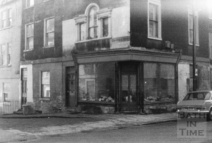 Shop front with a Venetian window on the corner of Walcot Street and Chatham Row, Bath 1960s
