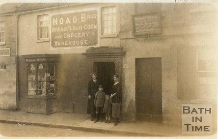 Shopkeeper posed on the steps of Noad's bakers c.1910