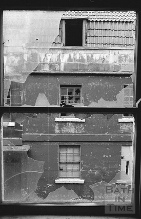 View through smashed windows of a house in St Anne's Place 1972