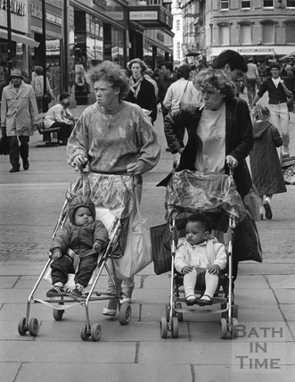Two young mothers pushing their children down Union Street