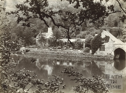 Cottage and boathouse on unknown lakeside,1892