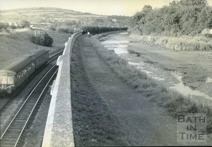 A train passing the Kennet and Avon Canal near Hampton Row, Bath c.1950