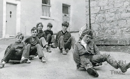 Six boys round the corner on their skateboards, probably in Ballance Street September 1970