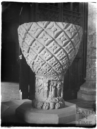 Saxon font inside the Church of the Holy Cross, Ramsbury, near Marlborough Wiltshire, c.1920s