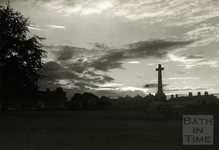 The war memorial at Combe Down at dusk, 1950s
