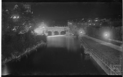 View of Pulteney Bridge from North Parade bridge at night. c.1900s