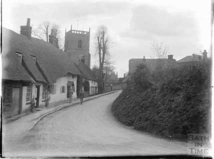 Street scene with church and timber framed houses, thought to be Wantage, Oxfordshire, c.1930s