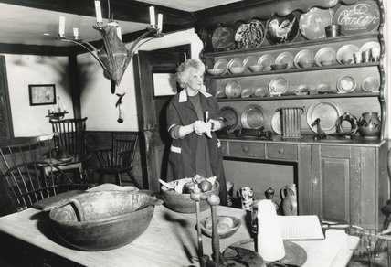 A cleaner inside one of the display rooms at the American Museum in Britain, February 3rd 1992