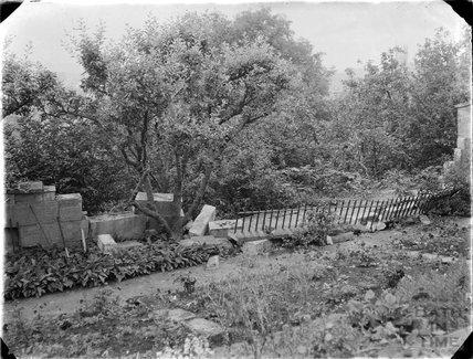 Damaged garden wall, c.1930s