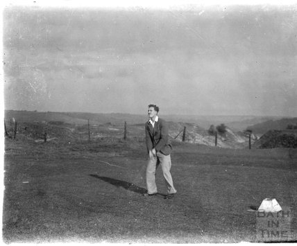 The photographer's son Rupert playing golf, c.1930s
