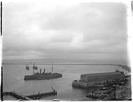 View of the harbour and warship at Weymouth, 1924