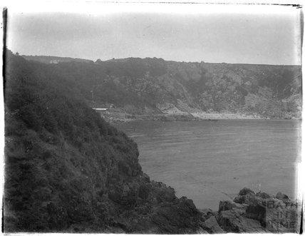 Cliffs and bay near Paignton, Devon, late 1920s