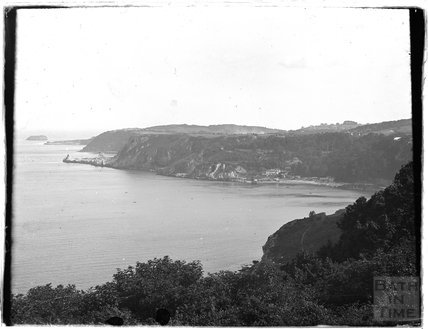 Cliffs and bay near Paignton, Devon, late 1920s