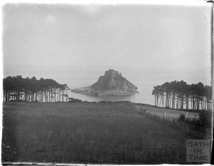 Thatcher Rock viewed through the trees in Torbay, Paignton, Devon, late 1920s