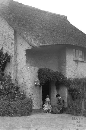 Sitting outside a thatched cottage, Minehead c.1905-1915 - detail