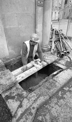 Fitting a conduit outside the Cross Bath, 8 December, 2000