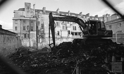 A digger on the site of the old Beau Street Baths.