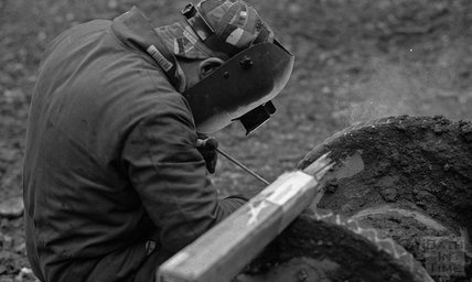 A welder, working on the drilling rig onsite at Thermae Bath Spa, 10 January 2001
