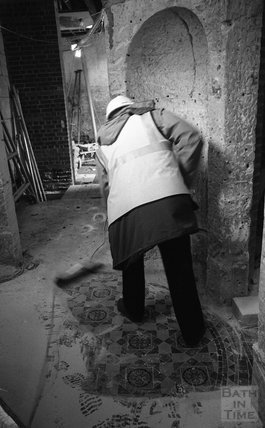Sweeping dust off the floor of the Hot Bath, 8 December, 2000