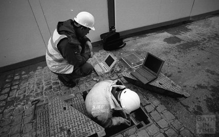 Engineers from Zenith with a laptop in Hot Bath Street, 24 January 2001