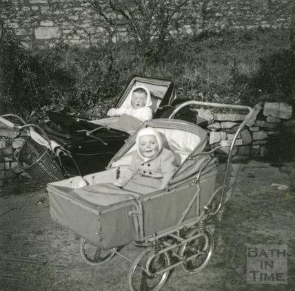 Two babies in prams in the garden of the Larkhall Inn, November 1952