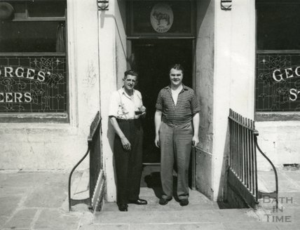 A couple standing outside the Larkhall Inn, c.1950s