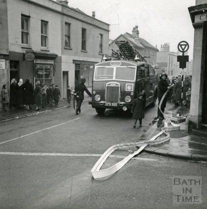 Fire engine in Larkhall pumping flood water, 1956