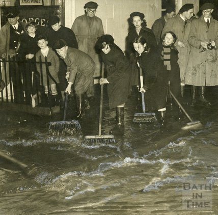 Mopping up the flood water outside the Larkhall Inn, 1956