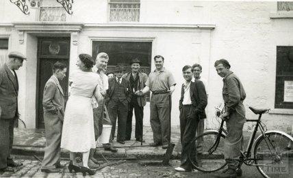 Landlord Tom Harper (holding bucket) outside the Larkhall Inn c.1950s